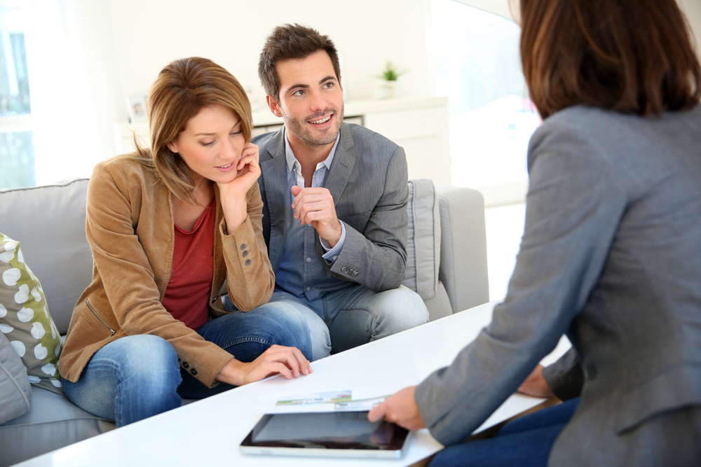 Couple meeting financial adviser for real estate project-1