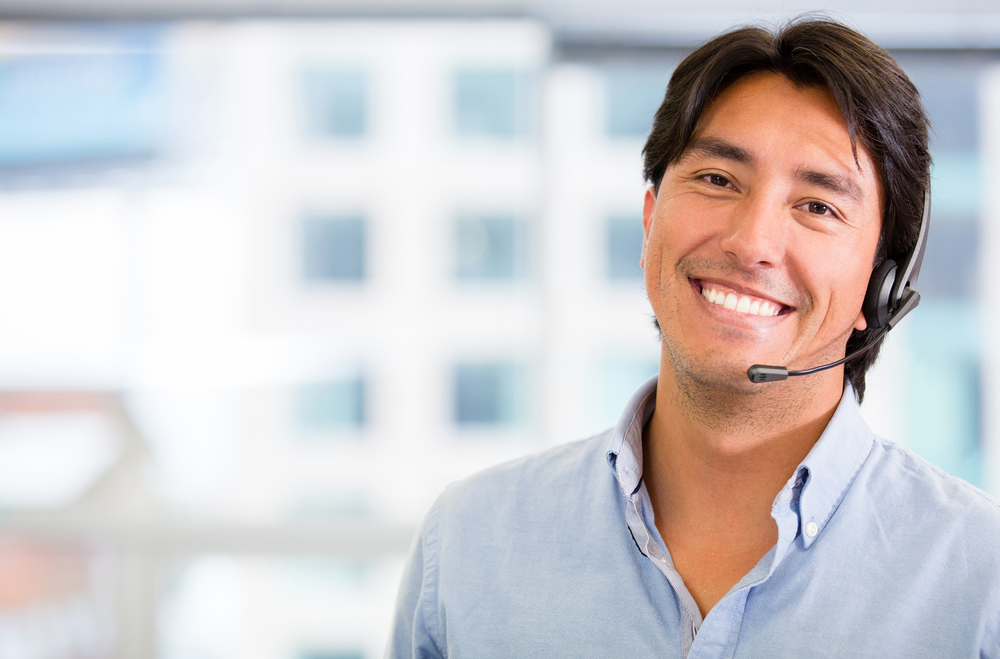 Customer service representative wearing a headset at the office